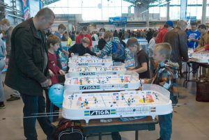 Saint - Petersburg, Russia - September 8, 2012: Children and adults play the table hockey Stiga Play Off. Public campaign I Choose Sport, organized by the Committee for Physical Culture and Sports of the Government of St-Petersburg and Lenexpo.